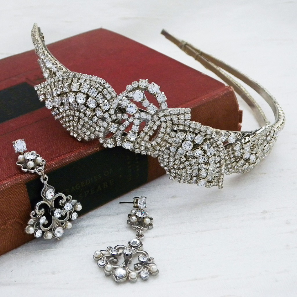 Finish your look with these vintage accessories. Modern vintage tiara by Erin Cole, chandelier earrings by Cheryl King Couture.