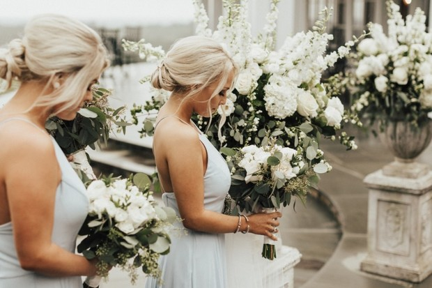 bridesmaids in soft blue with white bouquets