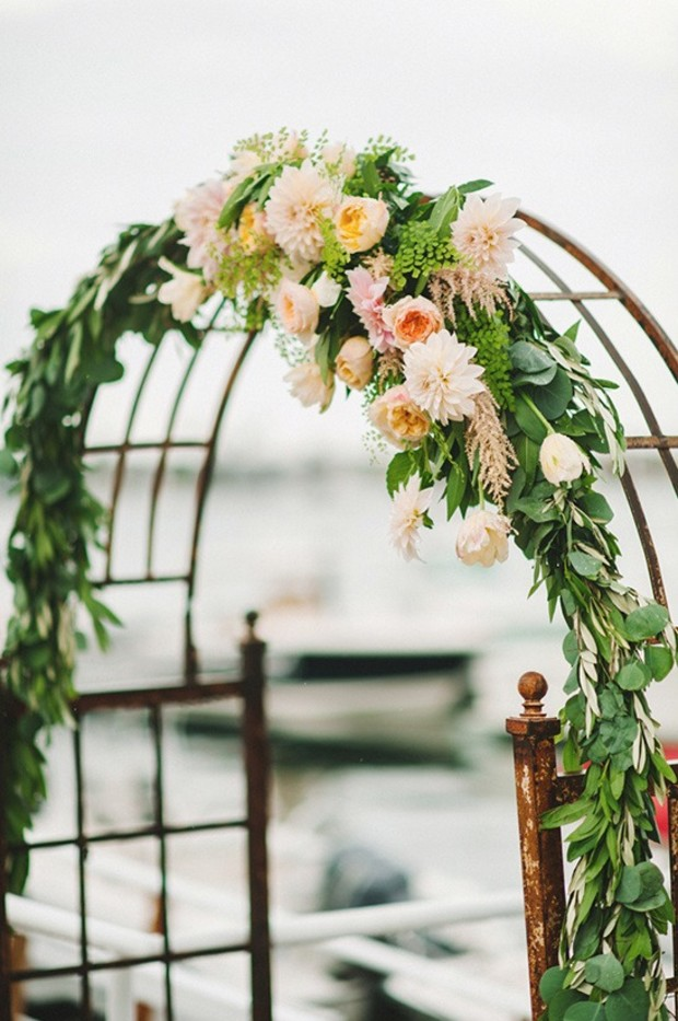 wedding floral arch in the rain
