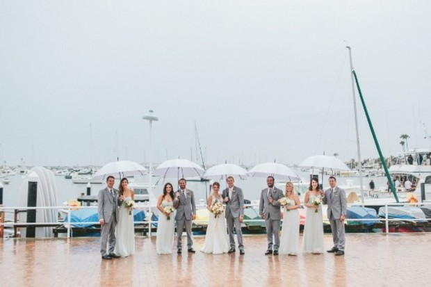 wedding party in the rain with umbrellas