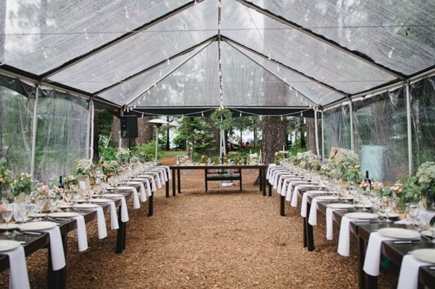 clear tented wedding reception so you can still see the rain