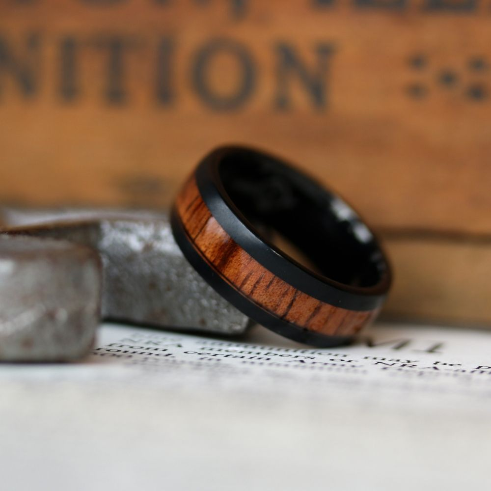 Mens black tungsten wedding ring with a koa wood inlay. The perfect men's wedding ring for those who enjoy the great outdoors.