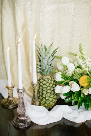 candles flowers and fruit wedding decor