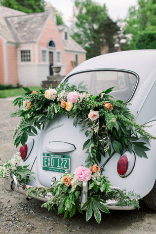 cute flower accented wedding car