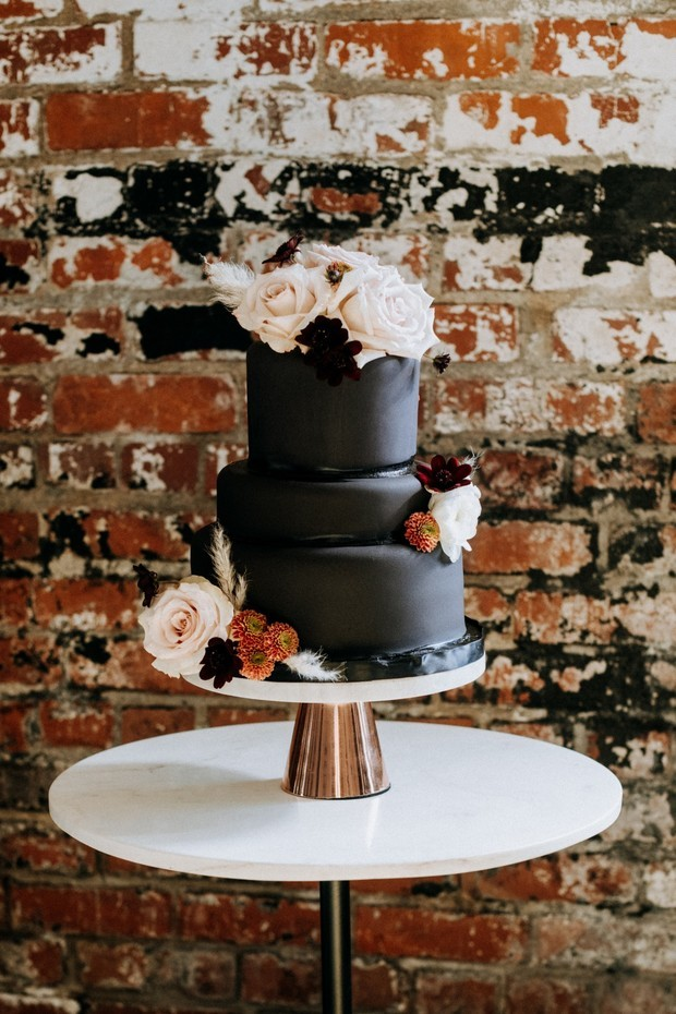 all black and flower topped cake
