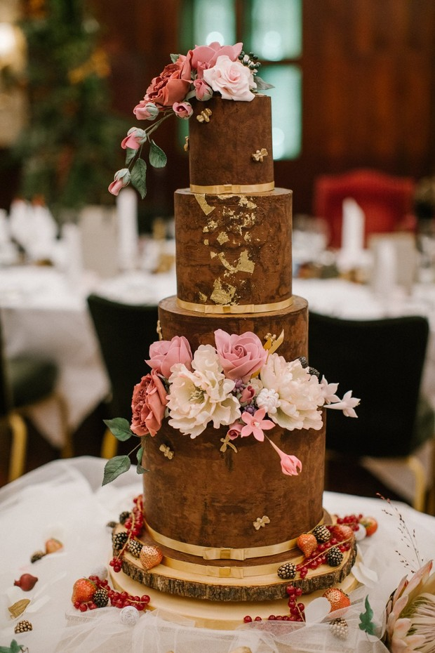 floral topped cake in brown and gold