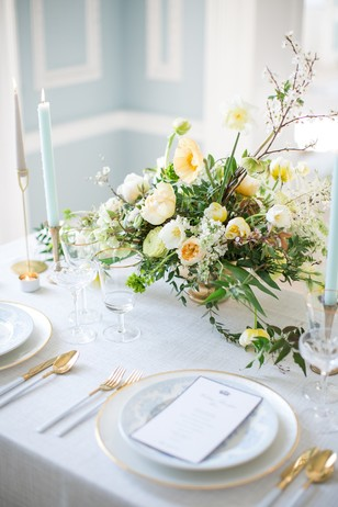 gold white and soft blue table decor