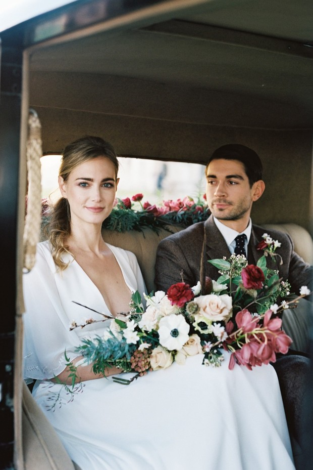 wedding couple in vintage ride