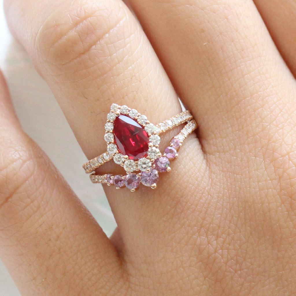 We love to mix and match our ring stacks with color! Here is our Pear Ruby Tiara Halo Ring in Pave Diamond Band with our Curved 7 Stone