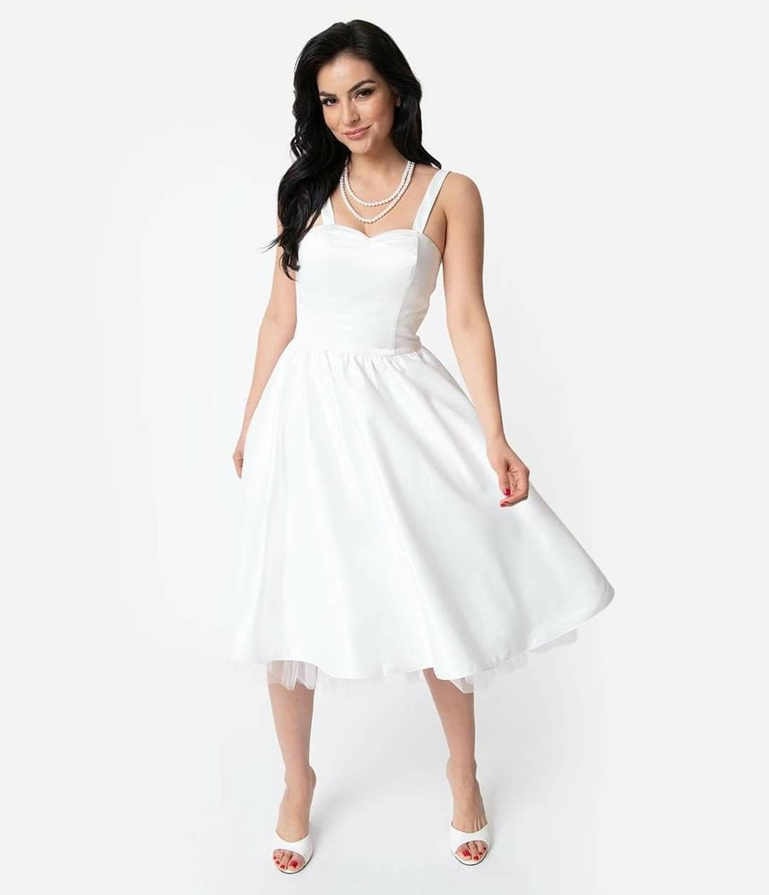 Say yes to your style. Removable straps allow for versatile versions of this tea-length wedding dress. From ceremony to reception it