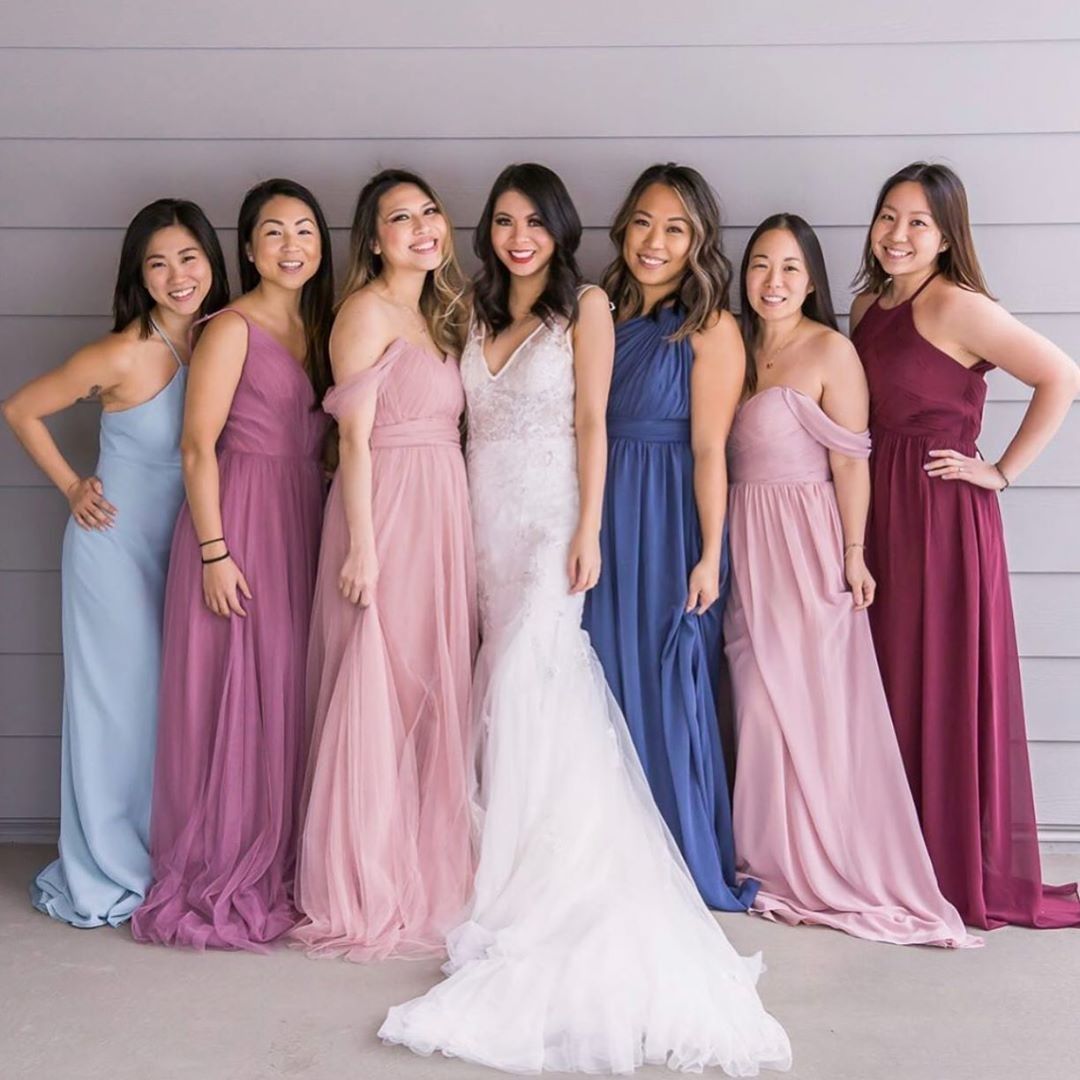 """Pops of pinks and beautiful blues for the picture-perfect big day """"I dos."""""""