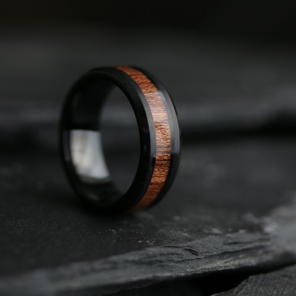 Yooper - Black tungsten wedding ring with a natural koa wood inlay. Over 36+ wooden wedding rings to pick from.