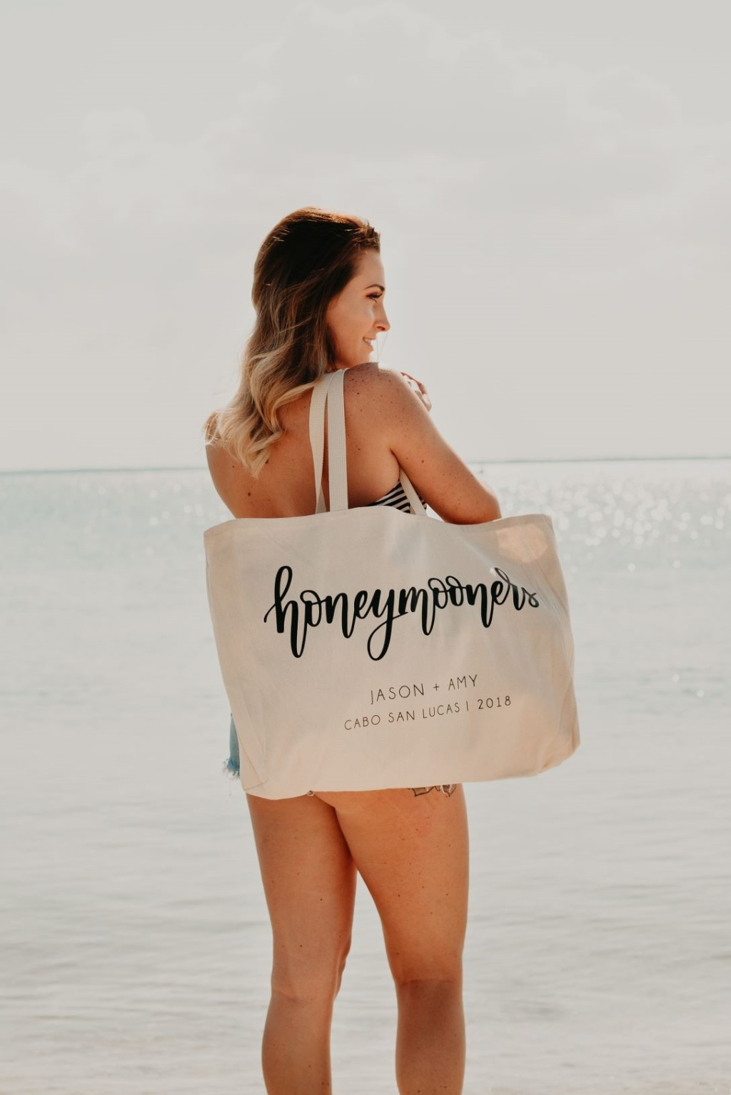 This large, lightweight canvas tote bag is perfect for toting around the beach essentials on your honeymoon! More designs available