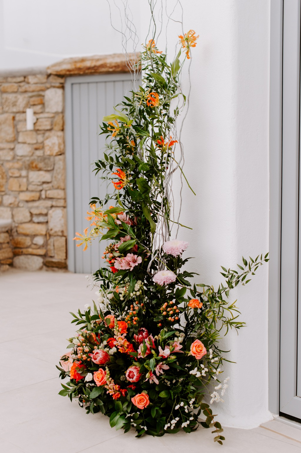 Coral Roses and Greenery in elopement Wedding!