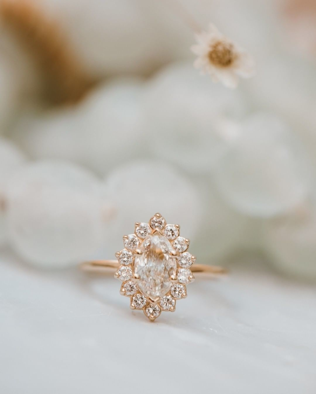 Dreamy champagne diamond ring with a starburst diamond halo available now at our Dairy Block location!