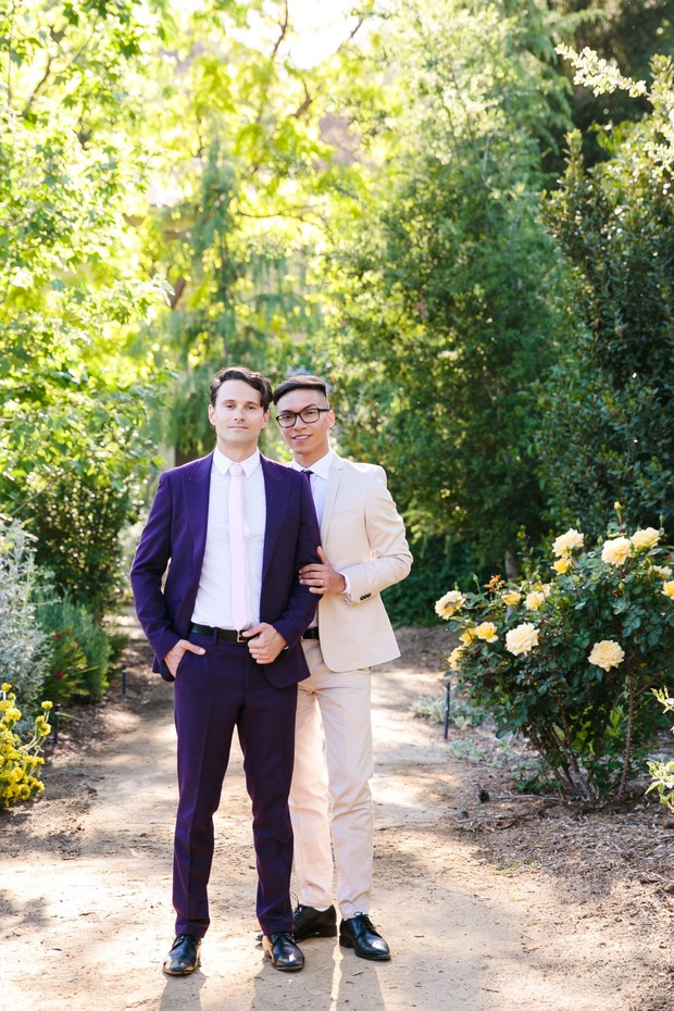 grooms in purple and ivory