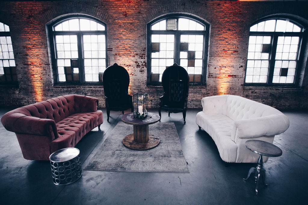 Check out this gorgeous vintage lounge setup in a former wire factory! Mixing and matching created a feel that was perfect for the