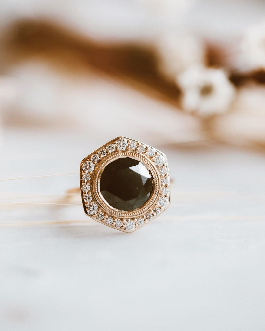 Make a statement with this swoon worthy black diamond ring with a hexagon pave diamond halo in 14k yellow gold. ✨