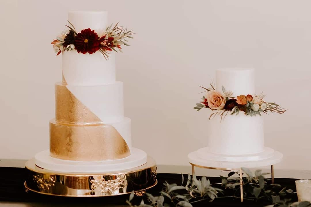 I cannot get enough pictures of this wedding. Buttercream cakes with gold and stenciled details.