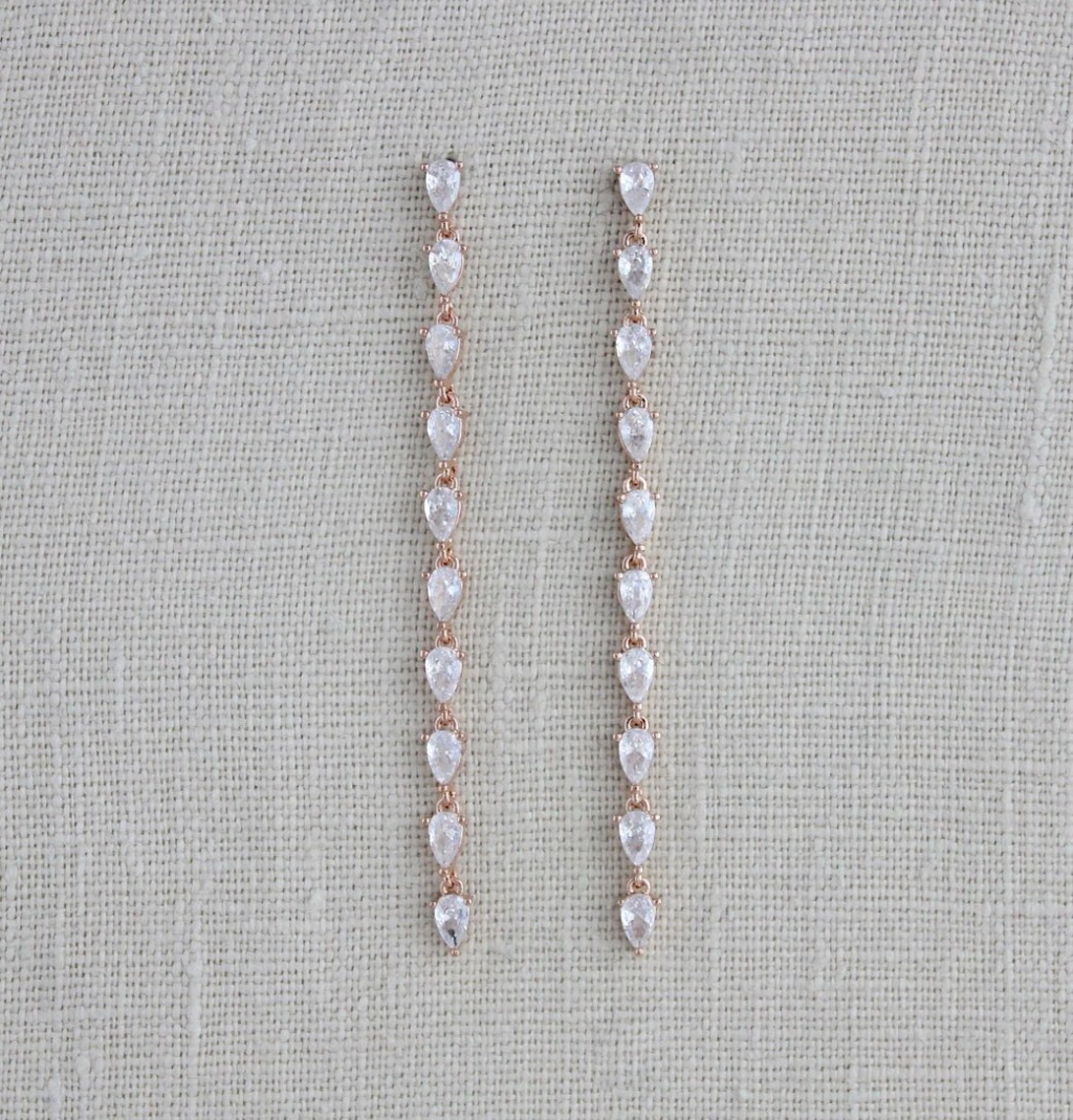 These long, thin and dainty minimalist Bridal earrings are finished in rose gold and set with gorgeous sparkly cz stones. Perfect understated