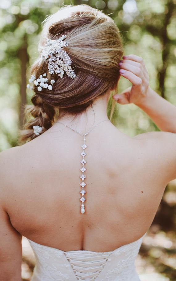 This simple rose gold backdrop necklace will gracefully adorn your wedding look, making you feel out-of-this world beautiful as you