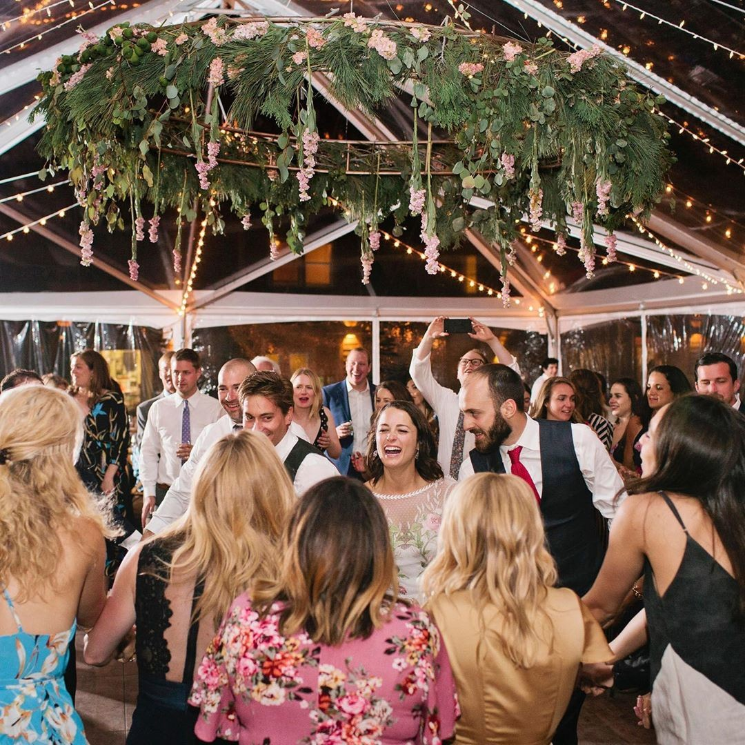 """A glorious glass ceiling party tent that rocks so hard during the reception, it practically bursts in jubilation. It's called"