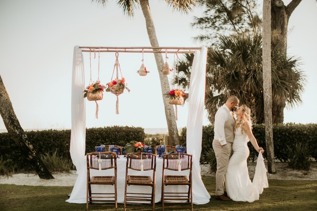 wedding table with boho hanging floral decor