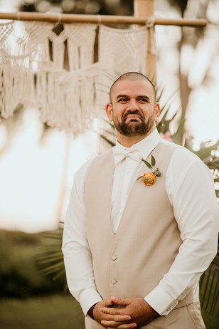 groom in white and tan