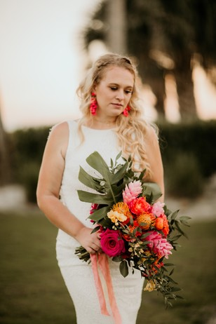 bride with tropical sunset inspired bouquet