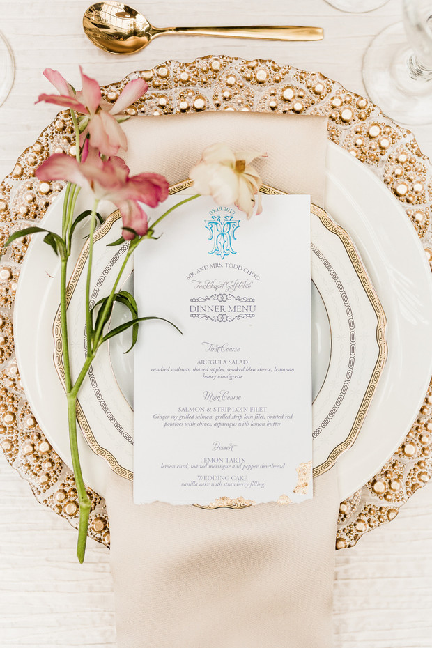 gold and white romantic and dramatic wedding place setting