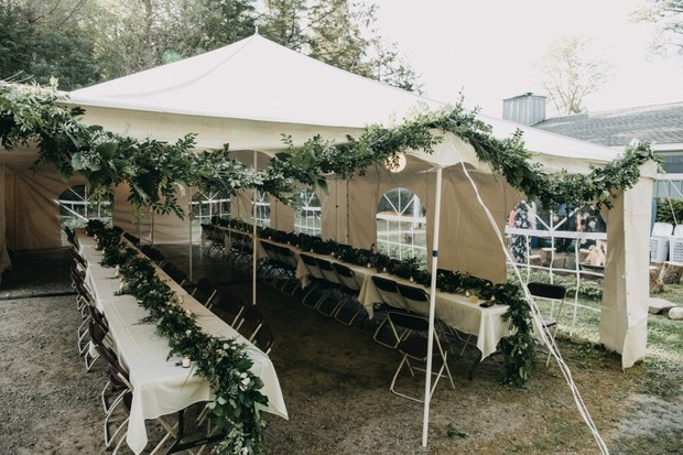 tent wedding reception with greenery