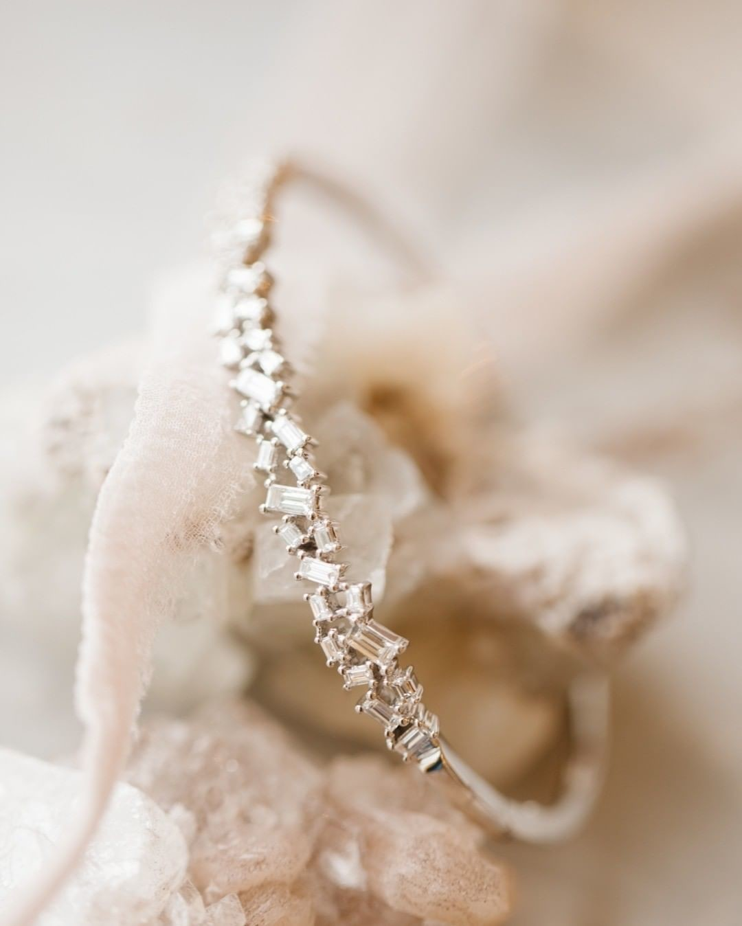 Oh baby! We are loving this baguette bangle beauty in white gold.