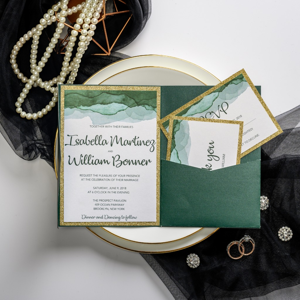 This uinque emerald green wedding invitation has gold shimmer backer and edge. Pocket on the side is practical to hold cards, you don