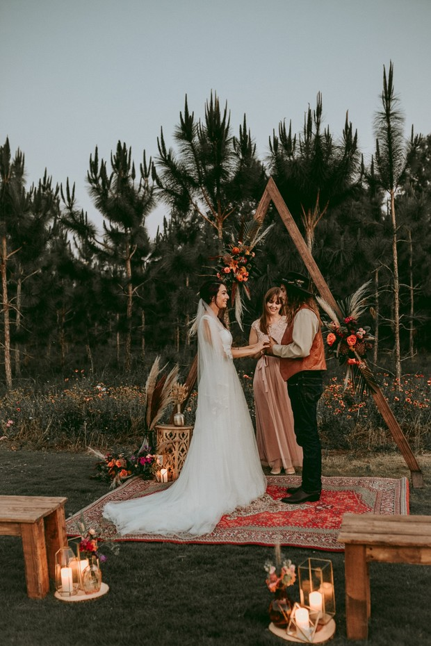 rustic candle lit wedding ceremony