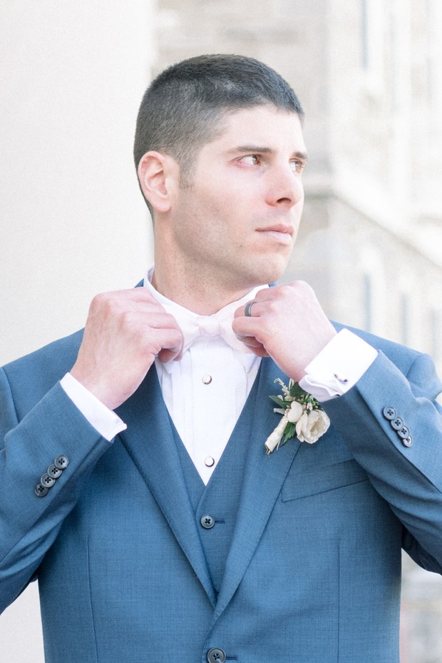 groom in blue suit and pink bow tie