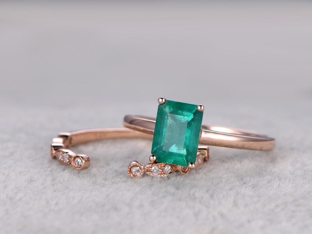 This is a 2pcs 6x8mm Emerald Cut emerald jewelry set,14k/18 gold with diamond matching band. The band is Stacking art deco open gap