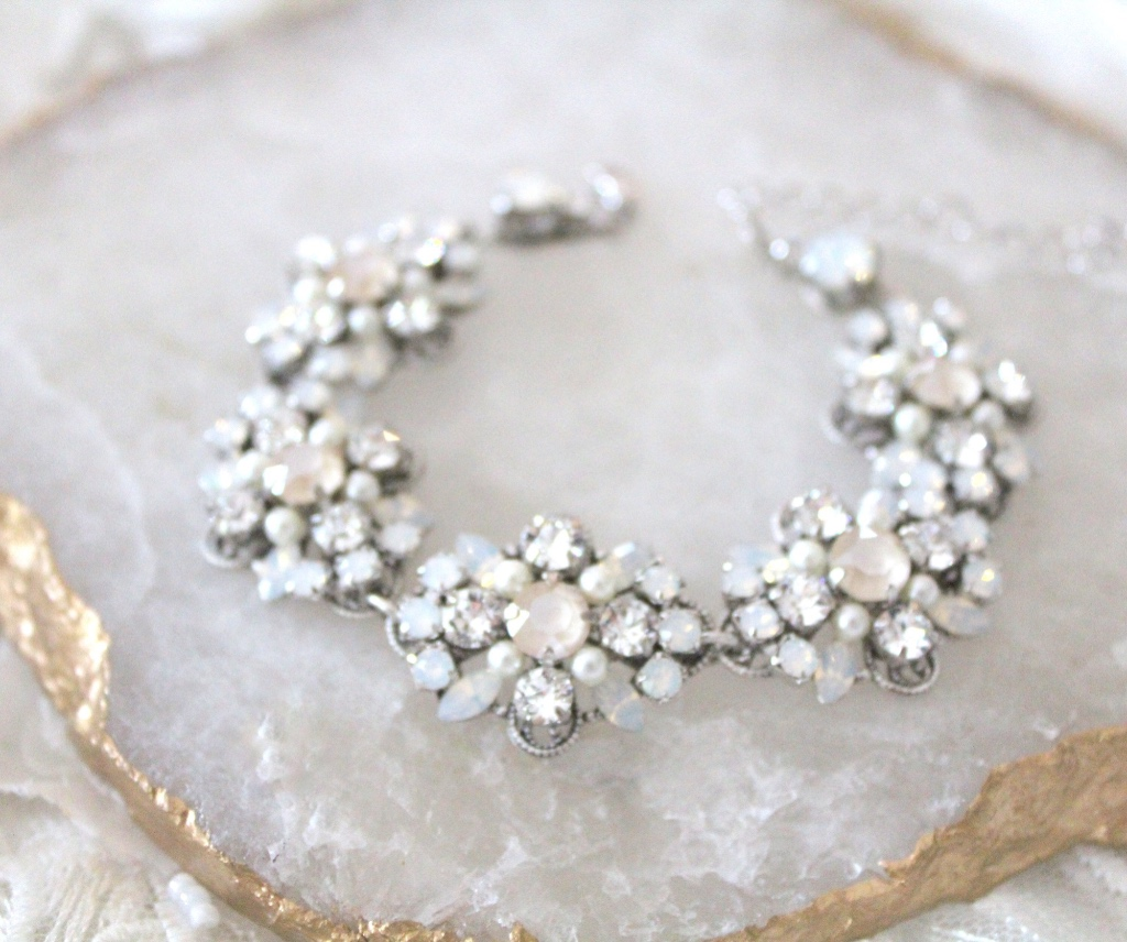 Bridal bracelet created with Swarovski ivory cream, white opal and clear stones with just a hint of tiny Swarovski pearls. A perfect