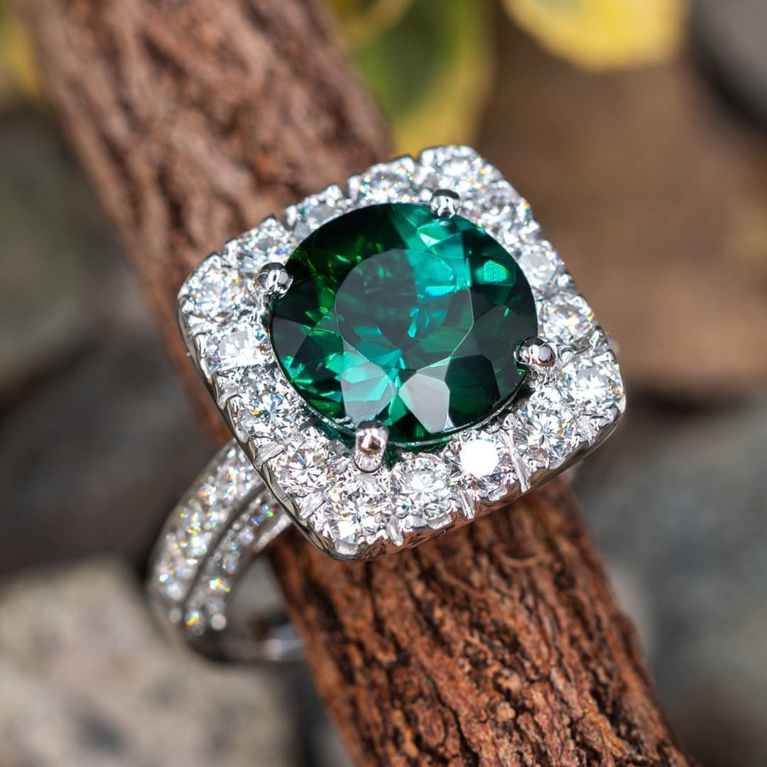 A stunning green tourmaline pops beautifully off bright white diamonds.