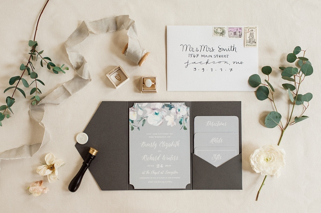 The Antique Blooms Wedding Invitations feature vintage, watercolored florals atop a moonstone background. Furthering the the design
