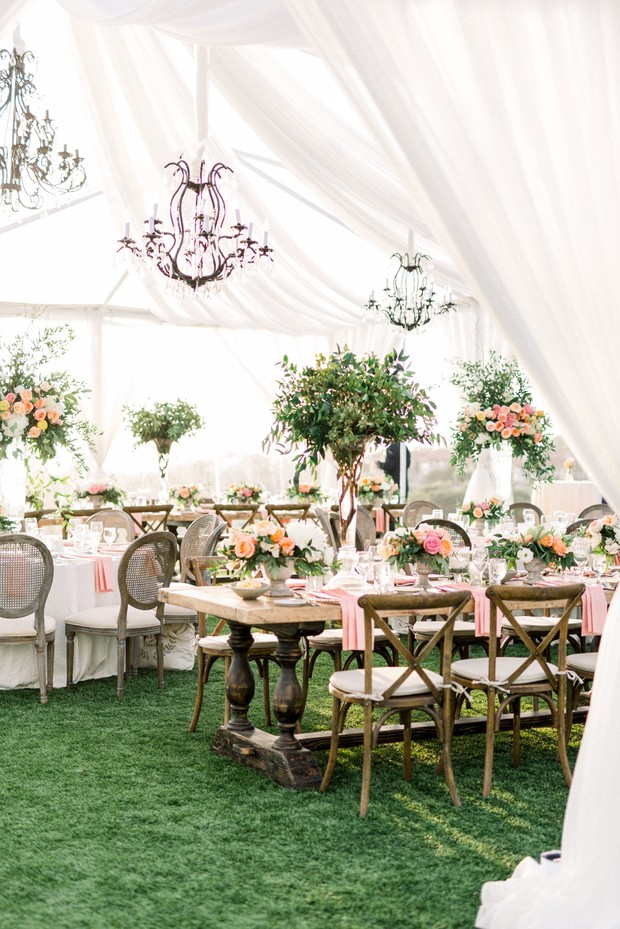 blush and coral wedding reception decor under a tent