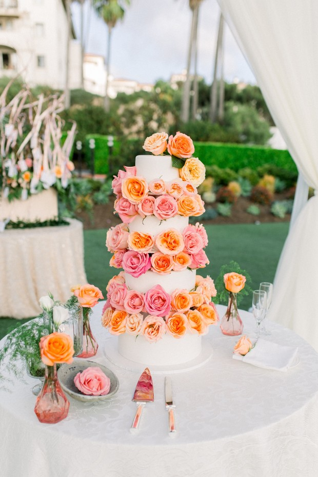 blush and peach flower accented wedding cake