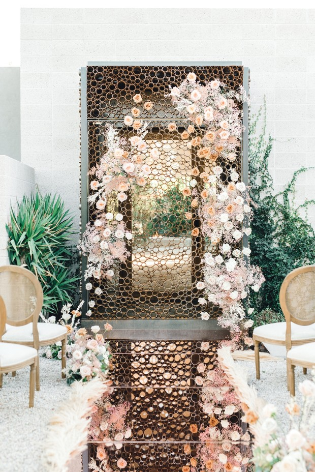 rose gold mirrored wedding aisle and floral decor