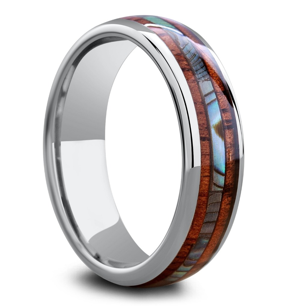 Men's tungsten wedding ring featuring a koa wood inlay with an abalone center stripe. This ring is available in widths 6mm and 8mm