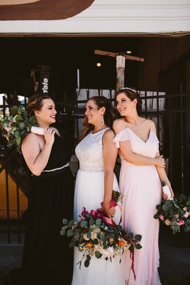 bridal party in black and pink
