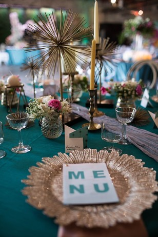 teal and gold wedding table decor with retro vibe