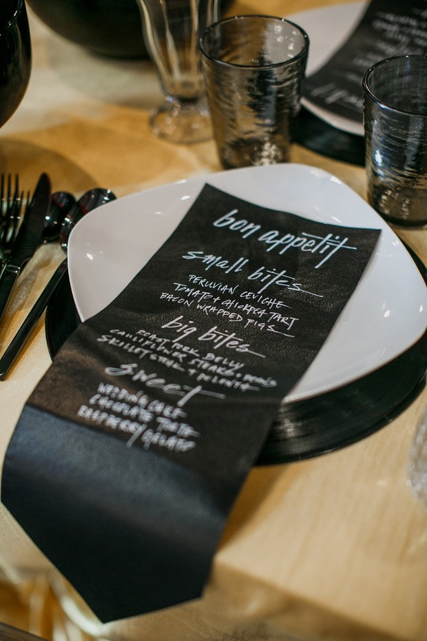 black and yellow wedding place setting