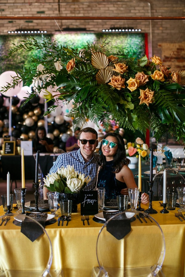yellow and black wedding table decor