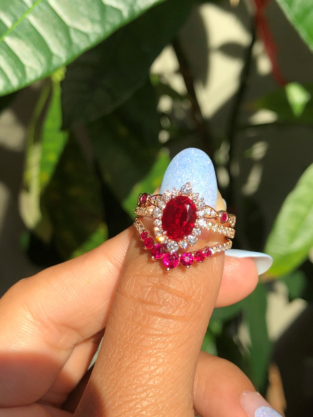 For all our Ruby Lovers here is your dream bridal set! This Ruby Bridal Set features our Oval Cut Tiara Halo Ruby Engagement Ring in