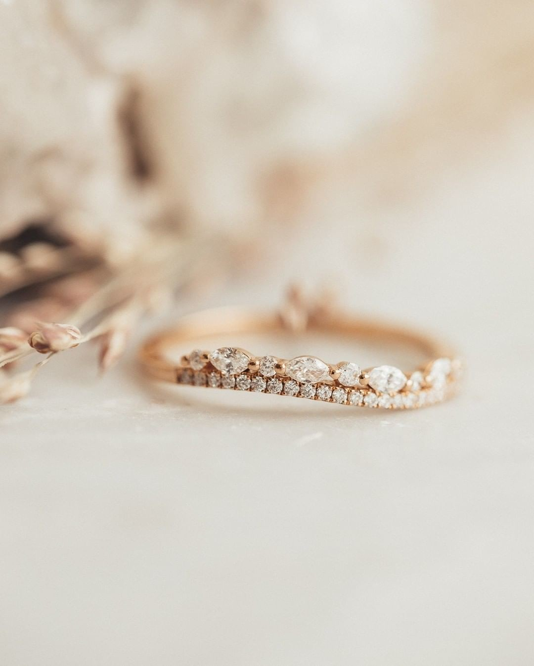 The perfect mix of marquise and round diamonds, this jaw dropping wave band in 18k rose gold has got us feelin' fancy this Friday!
