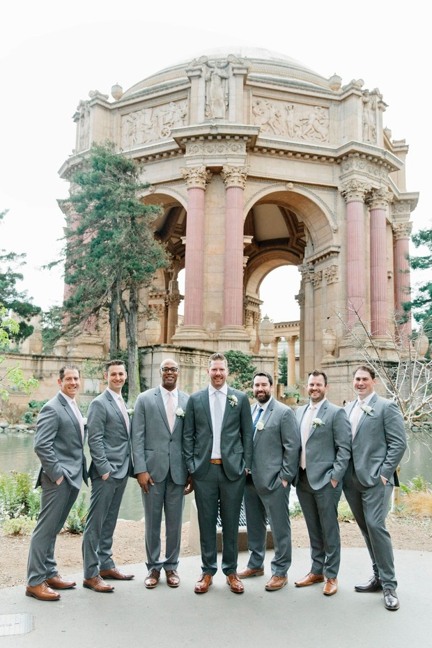 groom and his men in matching grey suits